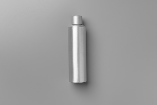 Gray haircare product on gray background top view
