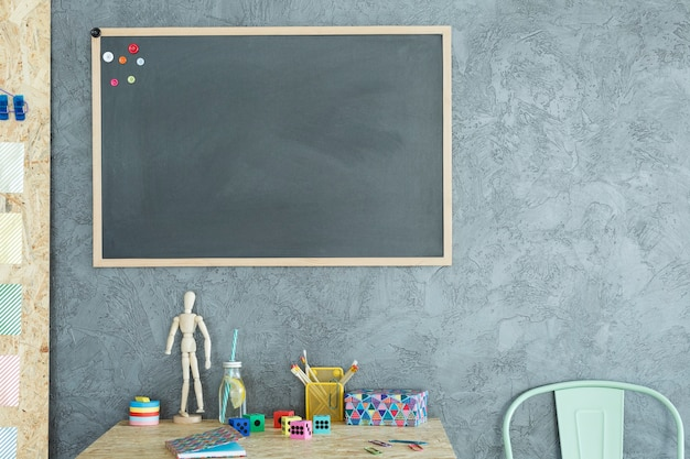 Gray home office with blackboard