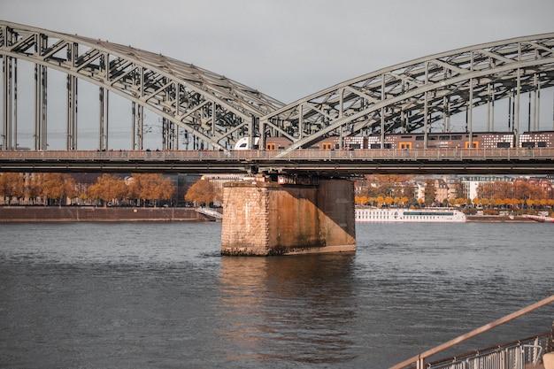 Gray iron bridge over a body of water