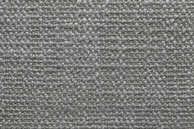 Gray knitted woolen background with a pattern of soft