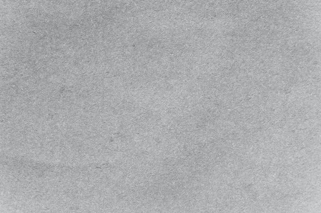 灰色のクラフト紙の織り目加工の背景