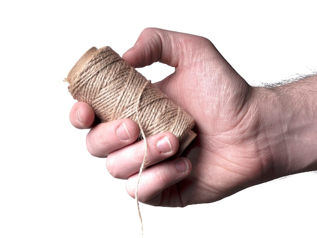 A gray leather thread is in a man's hand. gray thread and hand isolated on white background