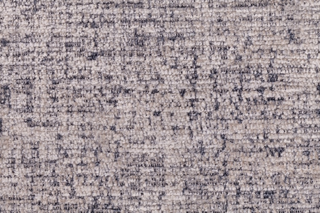Gray luffy background of soft, fleecy cloth. texture of textile closeup