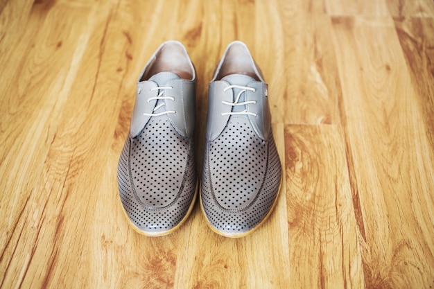 Gray man's shoes on the floor. men's style, fashion. charges groom.