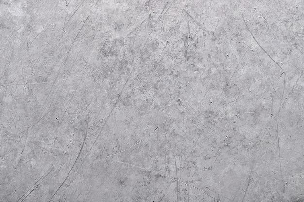 灰色の金属の背景、古い金属の質感のアルミニウムまたはチタン