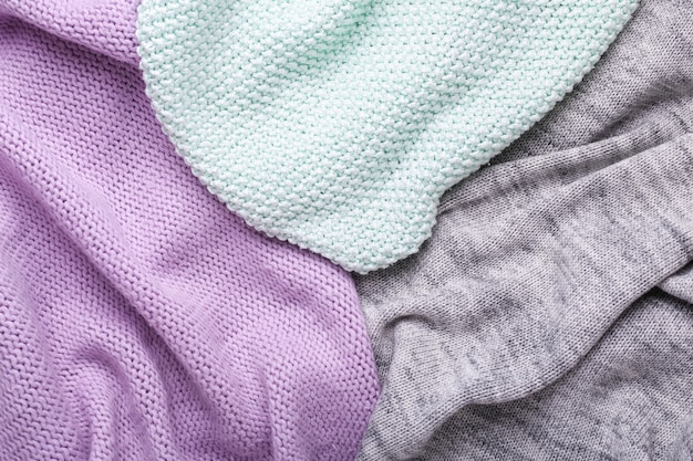Gray, mint and lilac knitting wool texture background crocheted fabric texture top view copy space