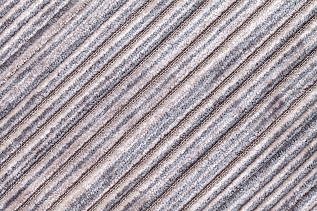 Gray multicolor background of a knitted textile material