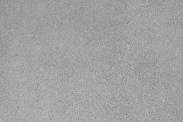 灰色の自然のセメントの壁のテクスチャ。セメント漆喰壁の背景。