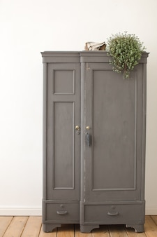 Gray old vintage cupboard in white interior