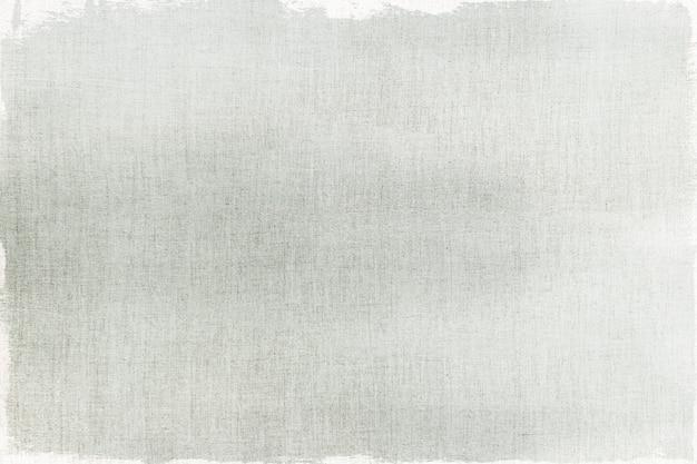 キャンバスの織り目加工の背景に灰色のペンキ