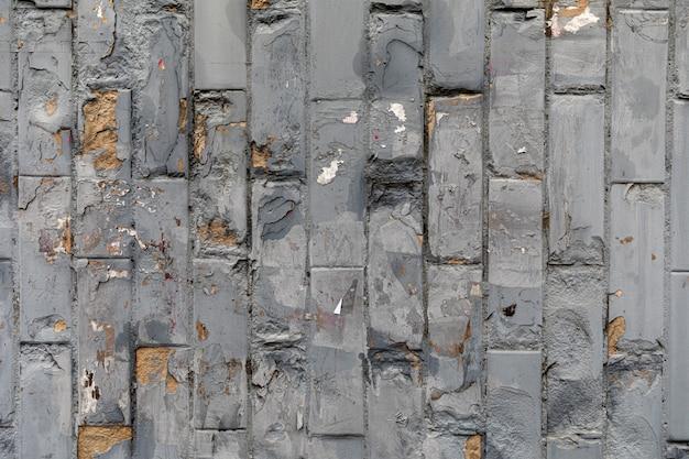 灰色塗られたレンガの壁
