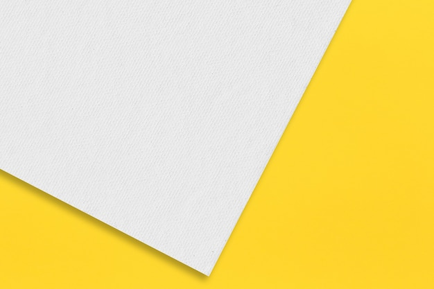 Gray paper is placed on top of the yellow paper