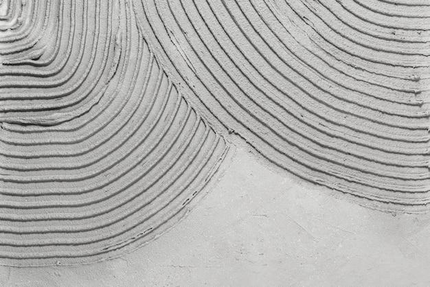 Серый узорчатый бетон текстурированный фон