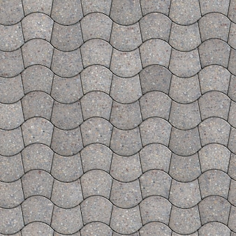 灰色の舗装-湾曲した台形。シームレスなタイル化可能なテクスチャ。