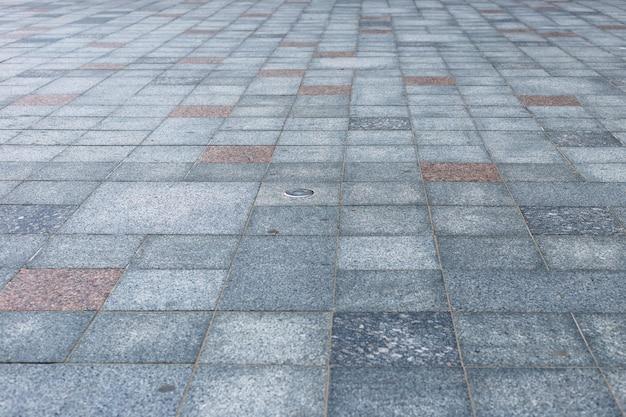 Серый крупный план тротуарной плитки. абстрактный фон