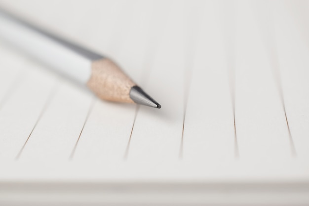 Gray pencil point to the empty area of note paper