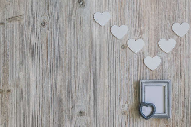 Gray photo frame with a heart and white hearts