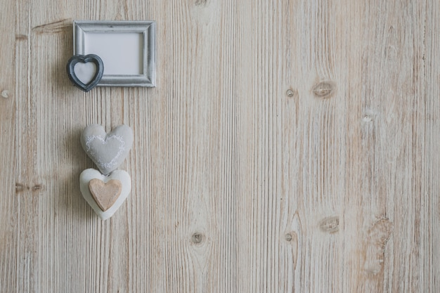 Gray photo frame with three hearts underneath