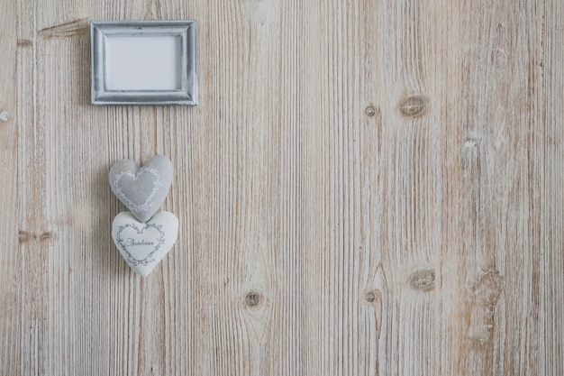 Gray photo frame with two hearts underneath