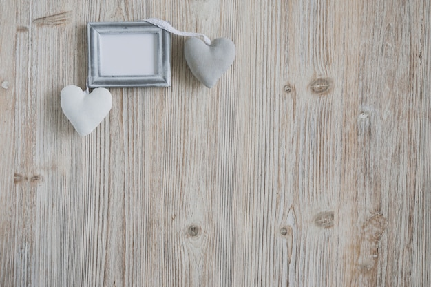 Gray photo frame with two hearts
