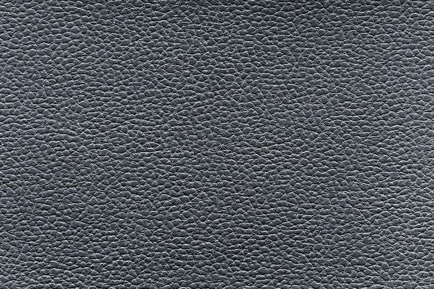 Серая пластиковая текстура из искусственной кожи крупным планом