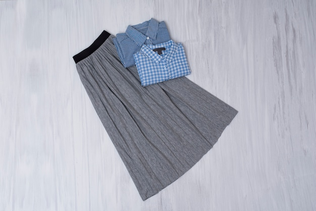 Gray pleated skirt and blue shirts. fashionable concept
