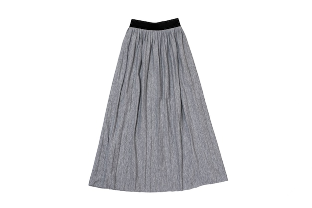 Серая юбка со складками на плоской подошве. модная концепция. изолировать на белом фоне.
