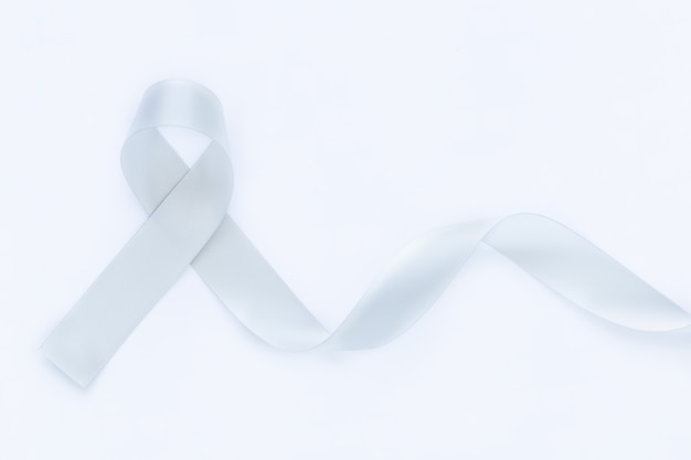Gray ribbon on white isolated background copy space. brain cancer awareness, brain tumors, allergies, asthma, diabetes awareness, aphasia disease, mental illness disorder. healthcare medical concept.