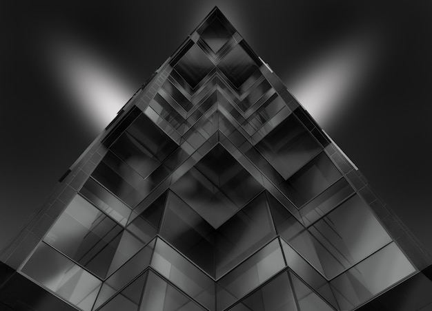 Gray scale low angle shot of a pyramid shaped glass building
