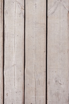 Gray scratched old wooden background. old tree on the street. vertical wooden background.