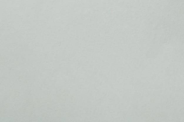 灰色光滑的织地不很细纸背景