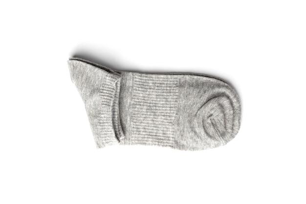 白で隔離の灰色の靴下