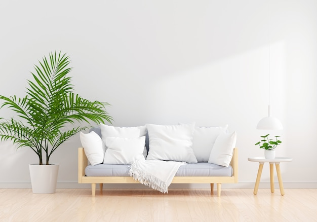 Серый диван в интерьере белой гостиной со свободным пространством