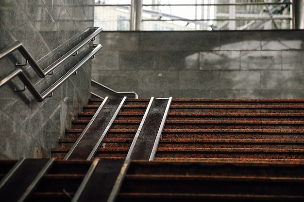 Gray staircase with a ramp for the disabled. urban architecture. exit from the metro or underground passage. high quality photo