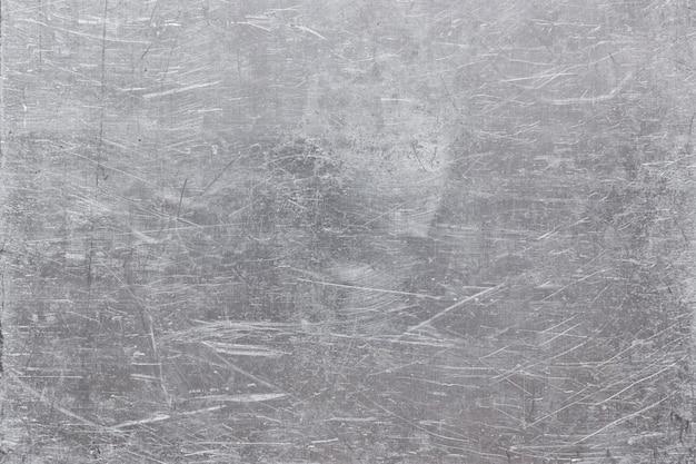 灰色の鋼板テクスチャ、銀色の光沢を持つグランジ金属の背景