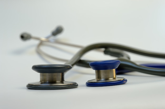 A gray stethoscope for adults and a blue stethoscope for children