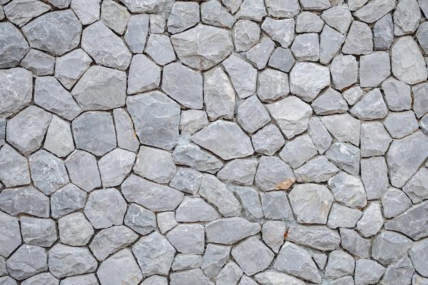 灰色の石造りの壁のテクスチャ