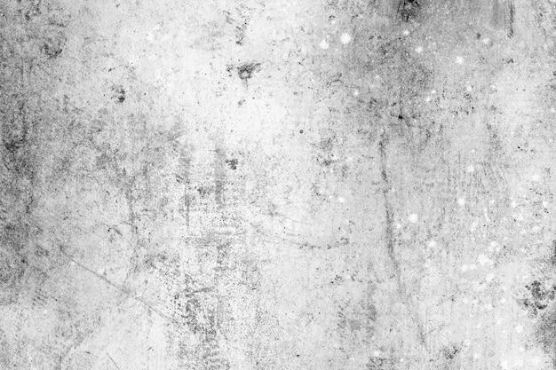 灰色の表面。抽象的な灰色の背景。灰色の漆喰の質感。暗い粗面。