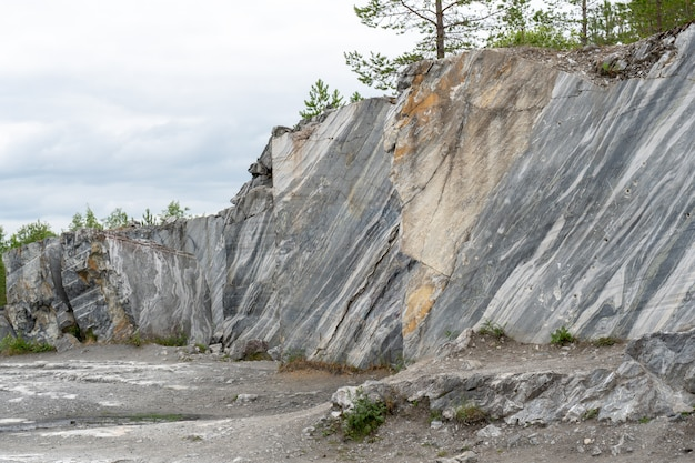 Gray surface of marble stone with striped streaks.