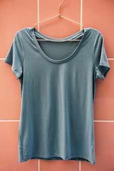 Gray tee hanging on the wall