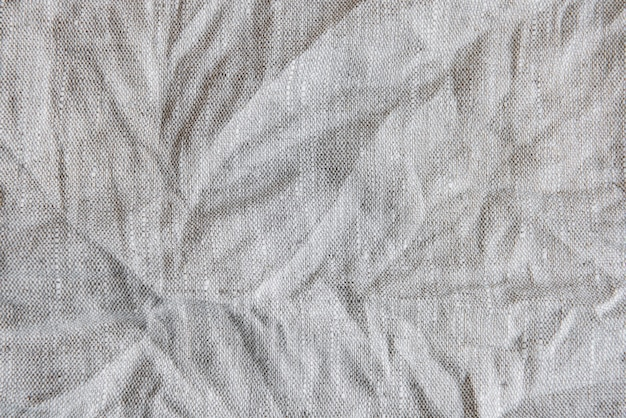 Gray textile linen tablecloth in full frame. cloth texture background. copy space.