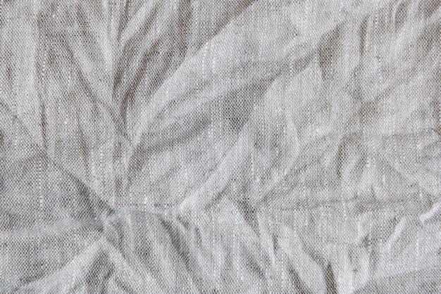전체 프레임의 회색 섬유 린넨 식탁보. 천 질감 배경입니다. 공간을 복사합니다.