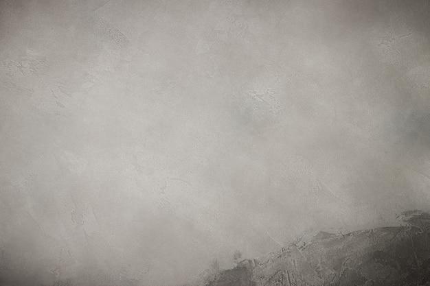 テキストのための場所と灰色の織り目加工の石の表面