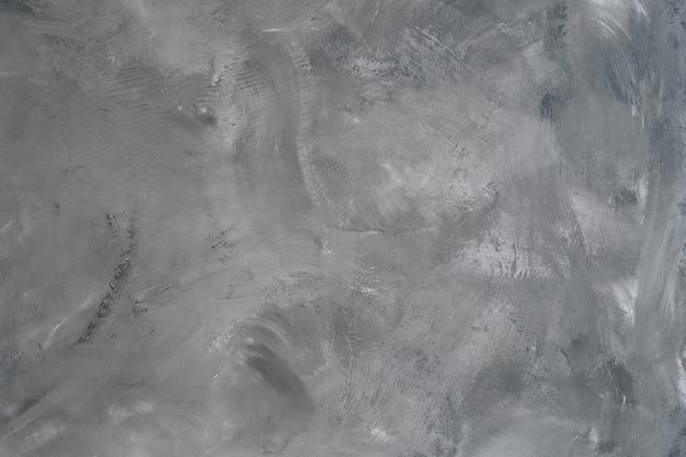 Superficie strutturata grigia su base in cemento e calcestruzzo