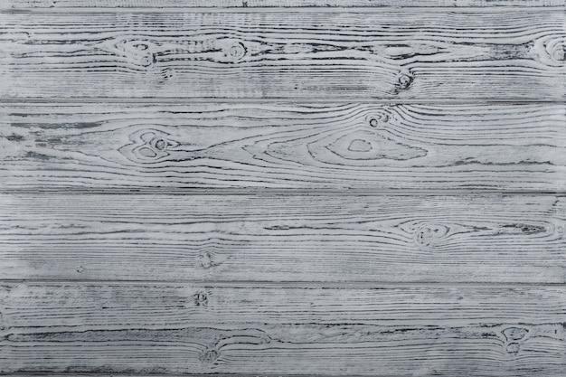 グレーの質感の木製テーブル。ブラッシング。木製の背景