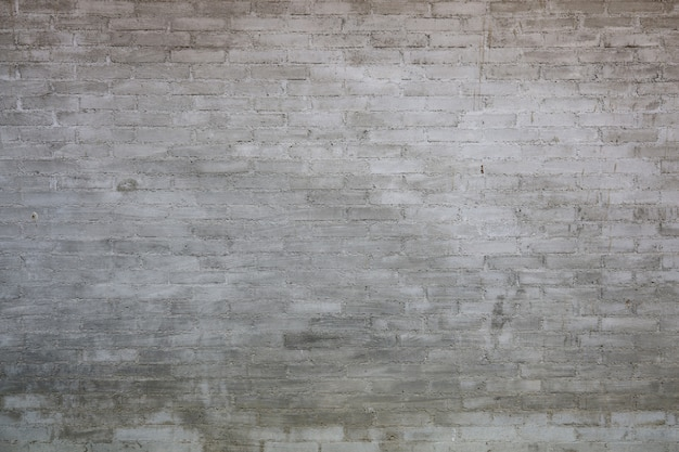 Gray tone old brick wall for wallpaper and vintage background