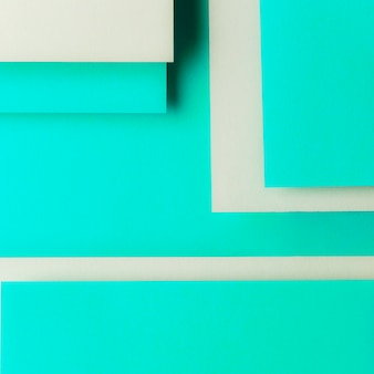 Gray and turquoise card paper in geometric shape