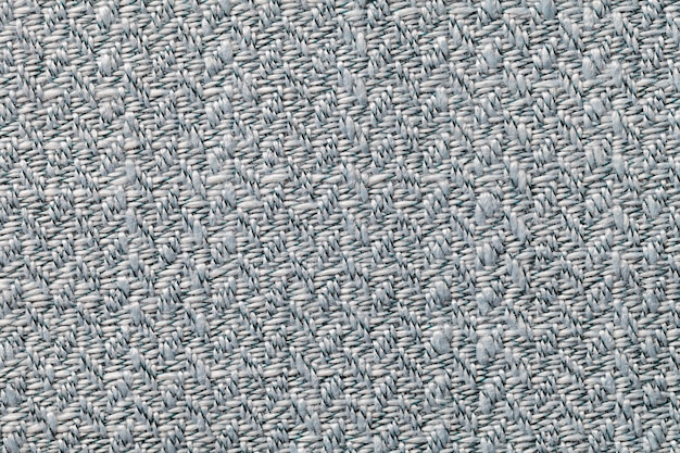 Gray vintage fabric with woven texture closeup. textile macro background