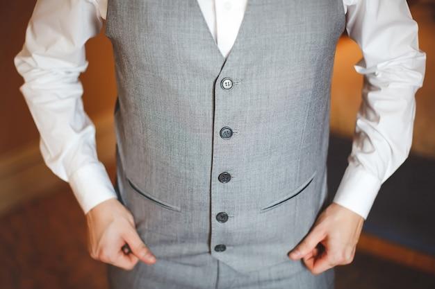The gray waistcoat to the groom. wedding day.