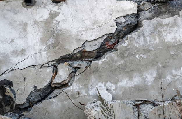 Gray wall with large crack